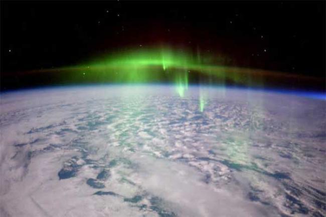 Flying through the Aurora's green fog