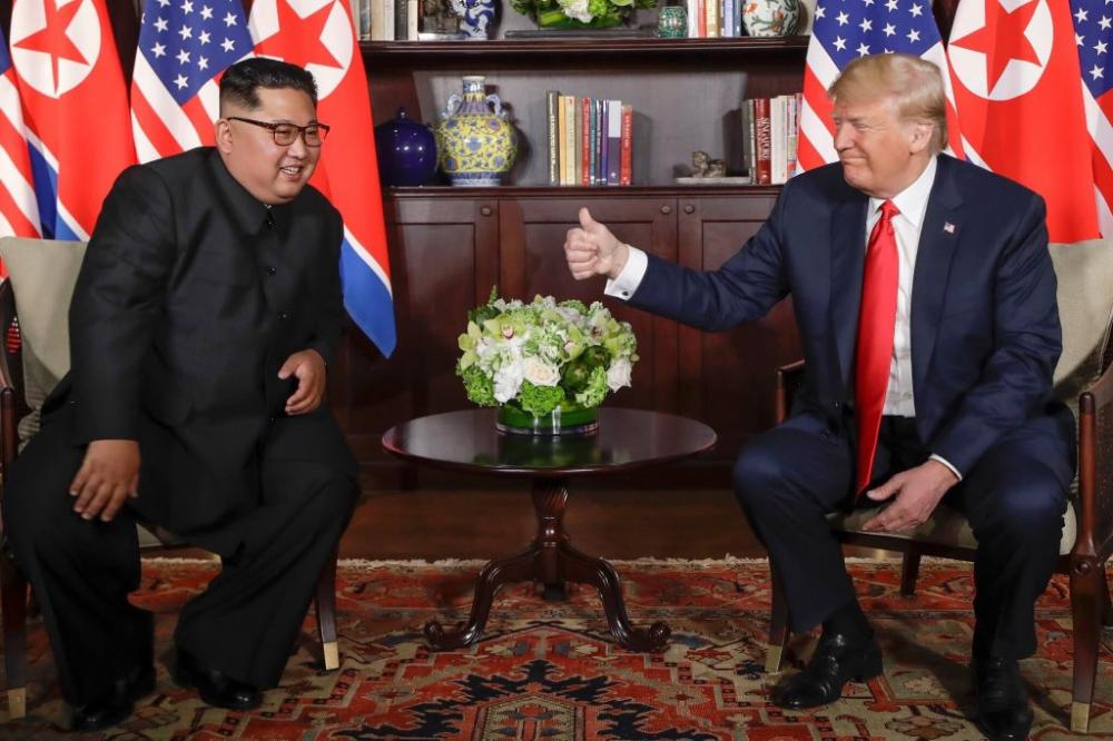 Trump pledges to end war games, Kim commits to denuclearization