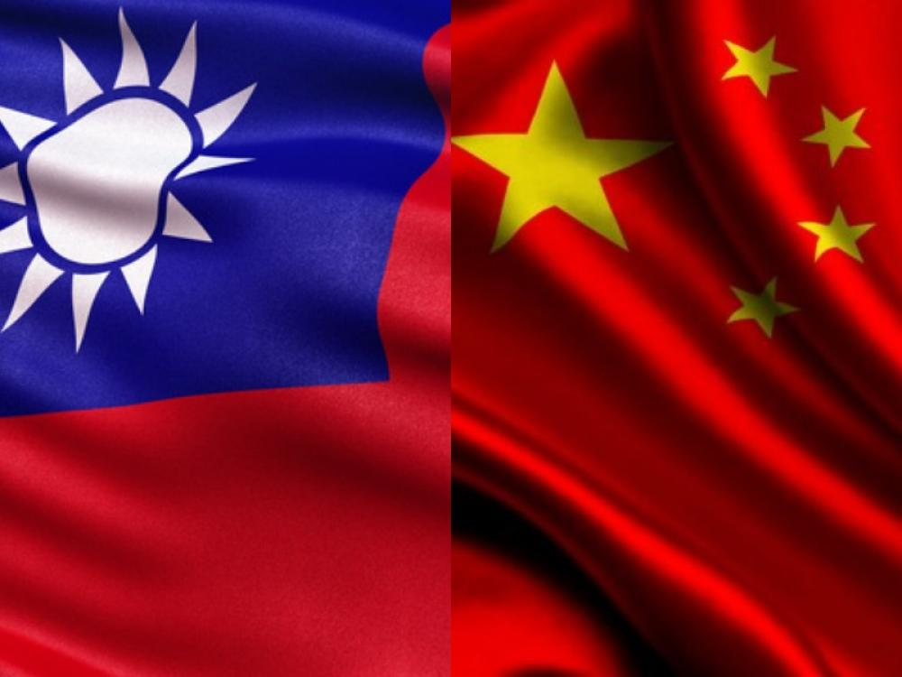 China warns Taiwan against spying; TV show details latter's plan