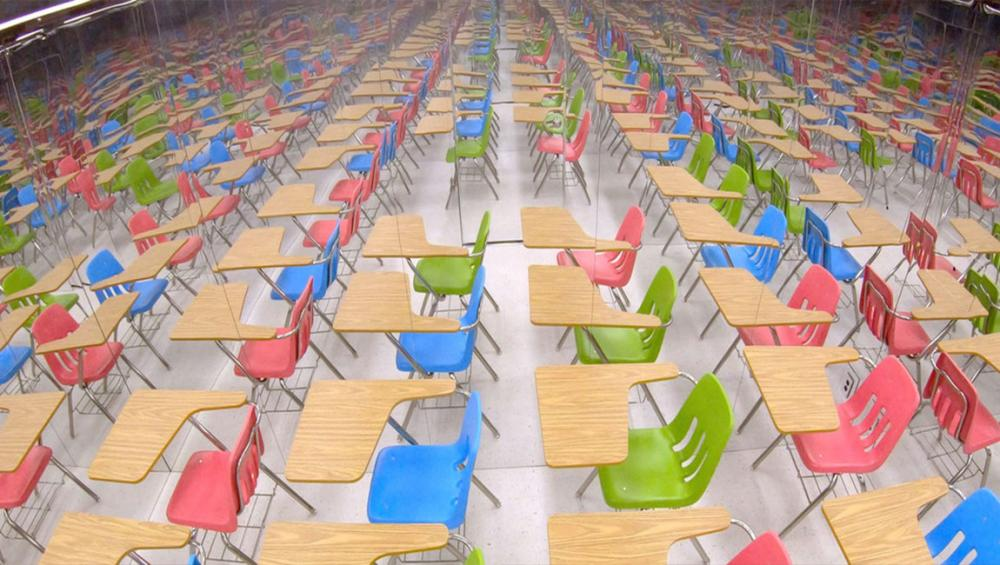 Mirrored classroom display highlights scale of massive education crisis