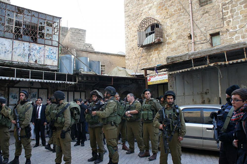 Two Israeli soldiers wounded, 14 Palestinians arrested in West Bank