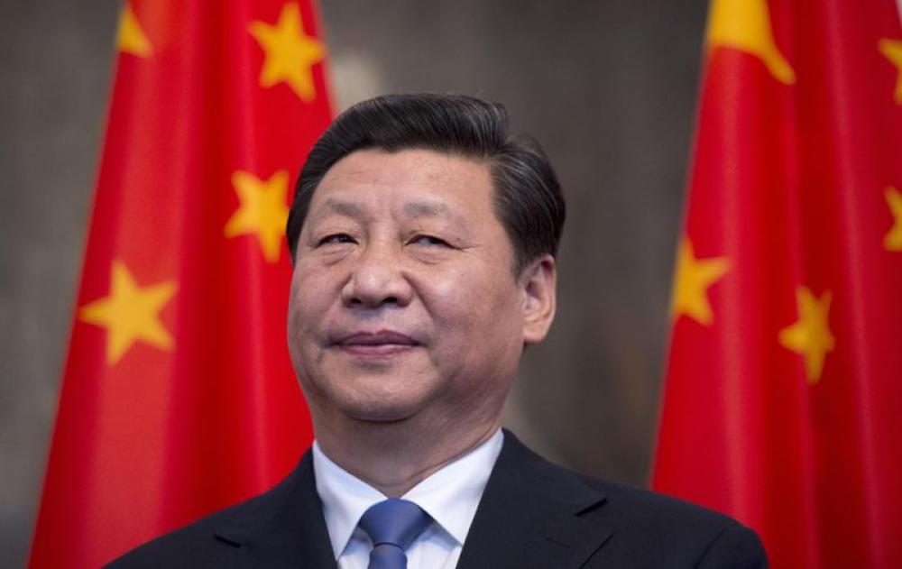 China to reduce tariffs, open up economy, Xi says at APEC forum