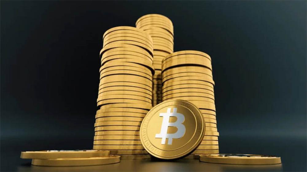 Bitcoin tops $58,000