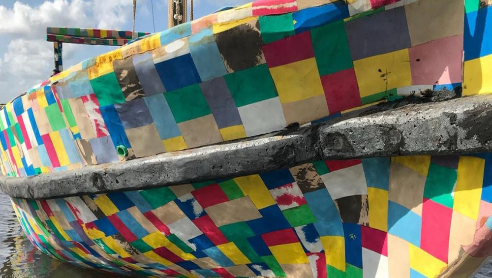 Boat made of recycled plastic and flip-flops inspires fight for cleaner seas along African coast