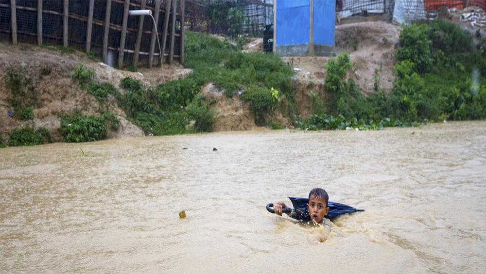 Monsoon rains turn millions of children's lives 'upside down' across South Asia