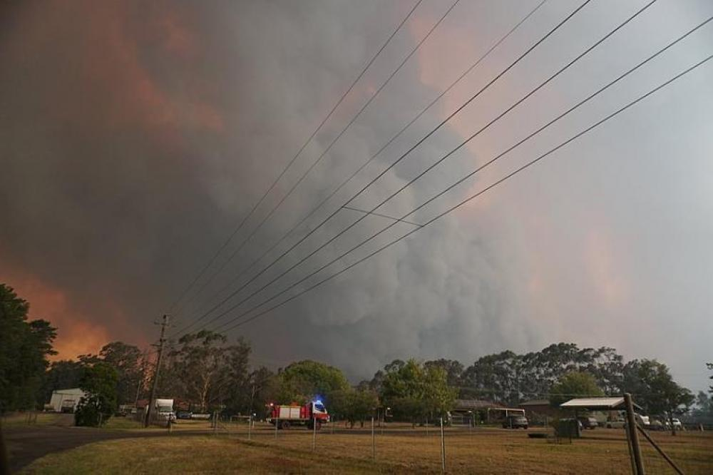 Climate denial wastes time amid Australian bushfire crisis: official