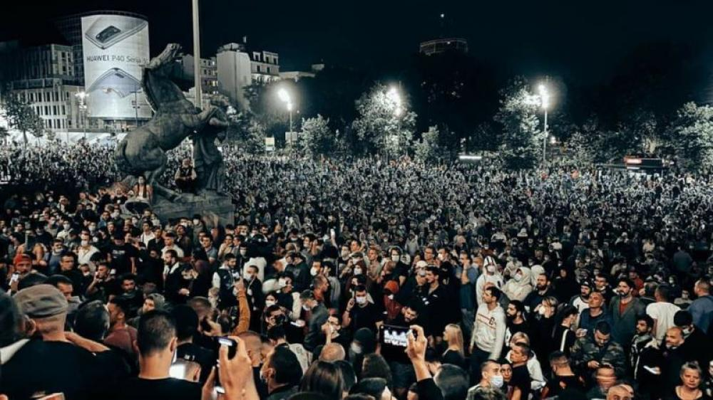 Protesters, police clash near Serbian Parliament over Covid-19 curfew