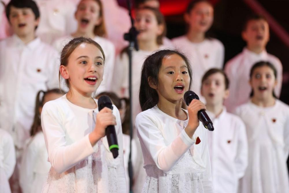 Children perform during a gala in Rome