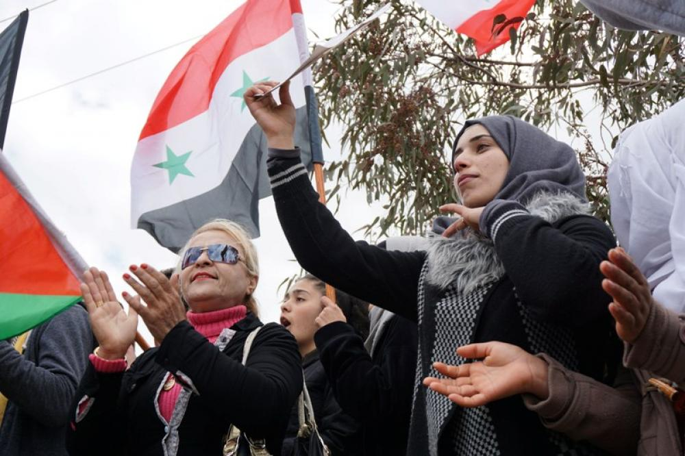 Syrians protest against US recognition of the Syrian Golan Heights as part of Israel
