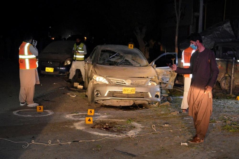 Security officials examine bomb blast in Quetta
