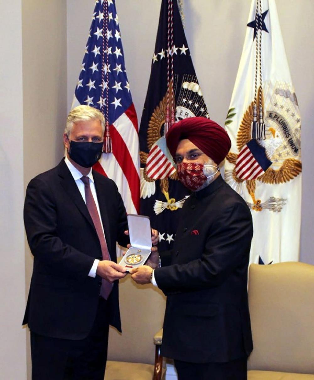 US President Donald Trump presents PM Modi with