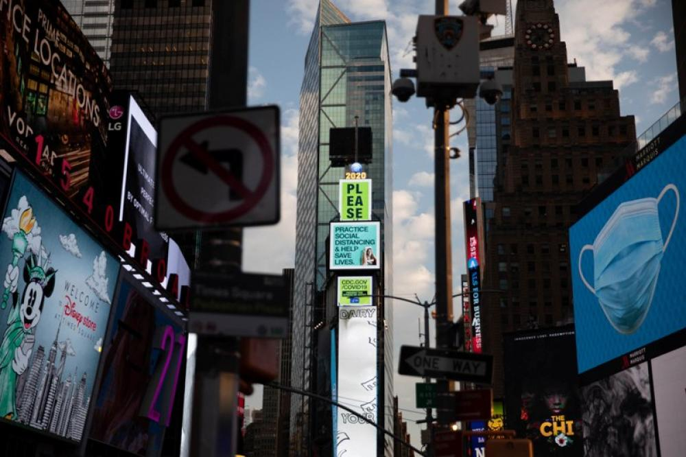 Billboards at Times Square in New York encourage people to maintain social distancing