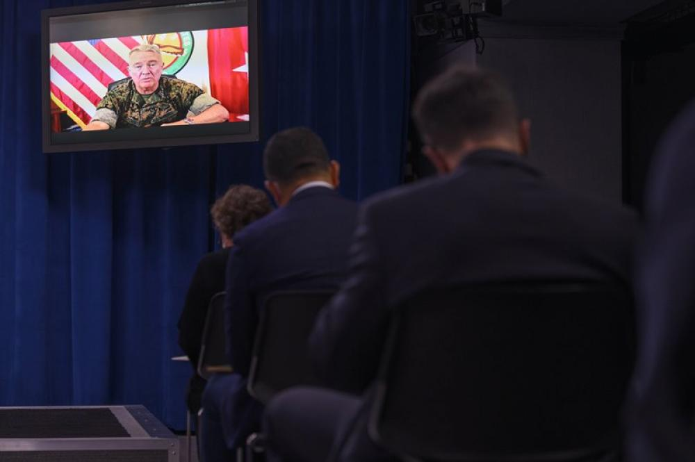 Kenneth McKenzie, commander of the U.S. Central Command, attends a Pentagon press briefing