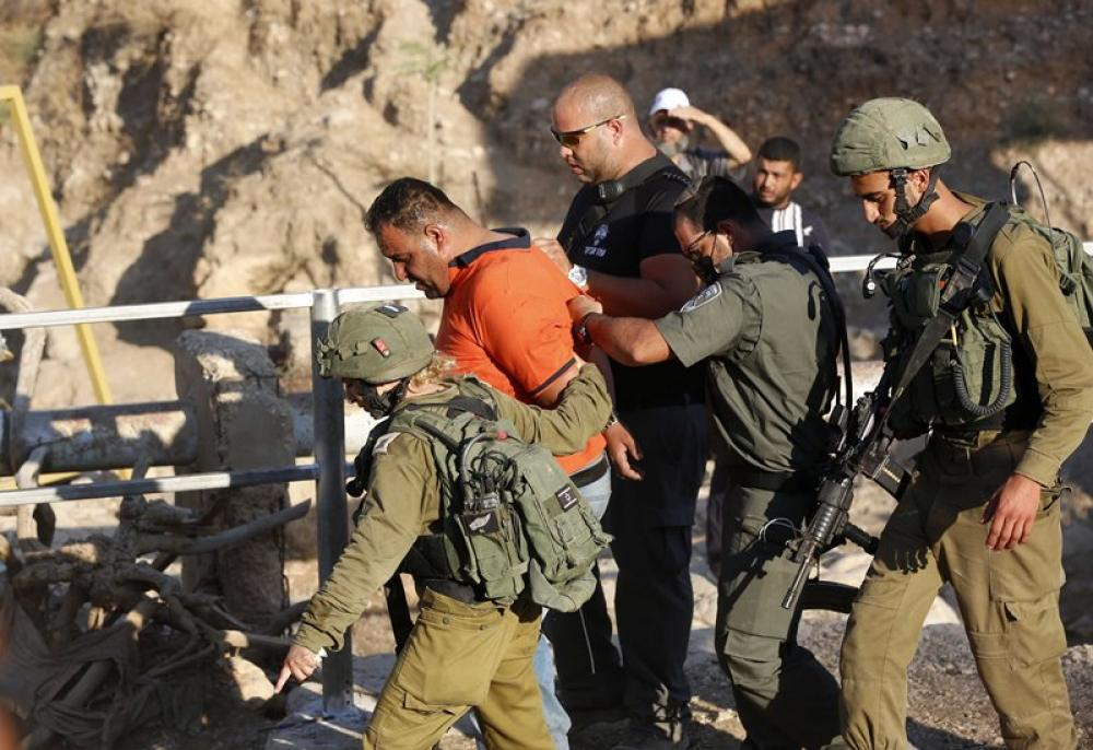 Israeli soldiers detain Palestinian protester during clashes in the northern part of Jordan valley