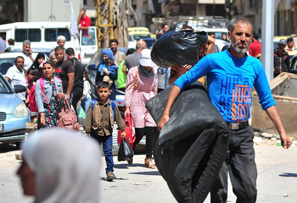 People return to homes in Syria's southern province