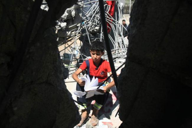 As civilian casualties rise in Gaza, UN Rights Council agrees probe into alleged 'war crimes'