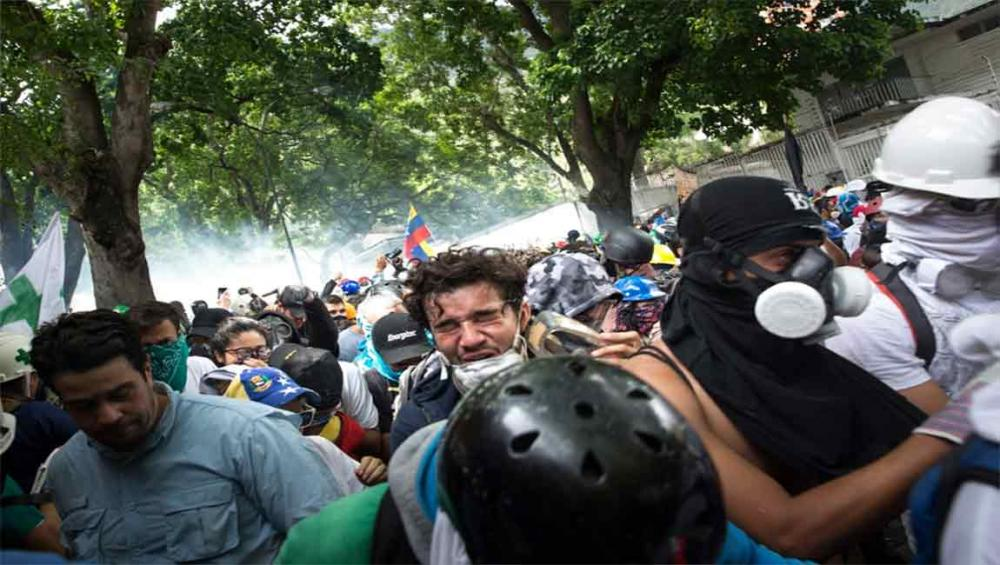 Venezuela: UN rights office urges all parties to refrain from violence amid protests over Sunday's elections