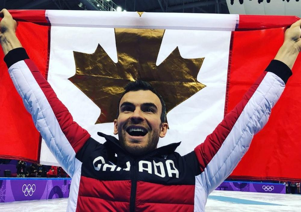 Gay Canadian figure skater Eric Radford creates history at the Winter Olympics