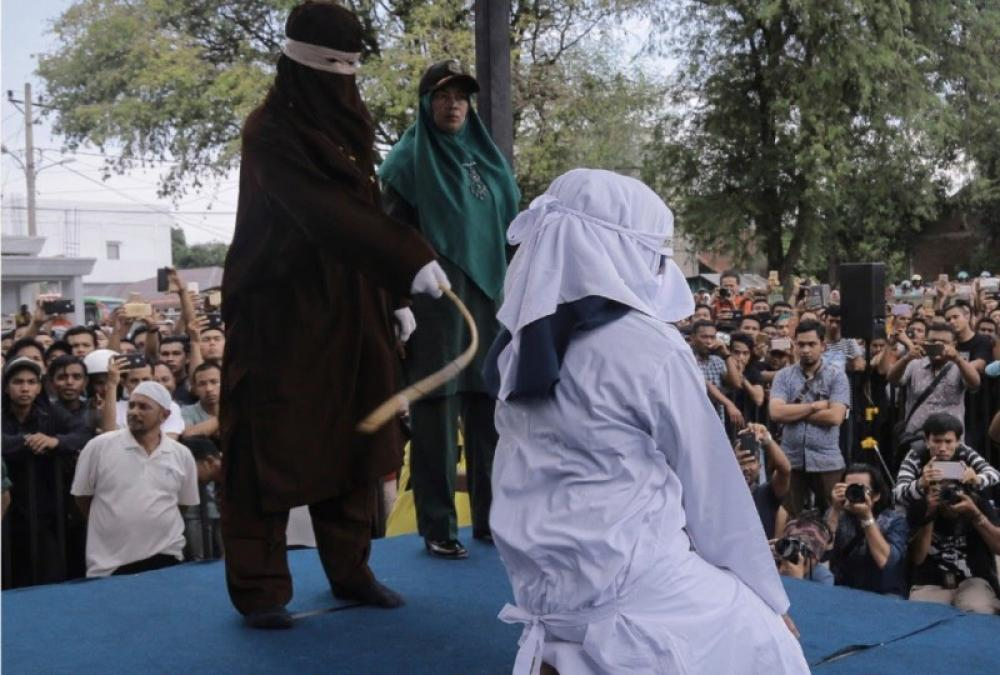 Malaysian women caned in public for indulging in lesbian sex; lawyer justifies punishment