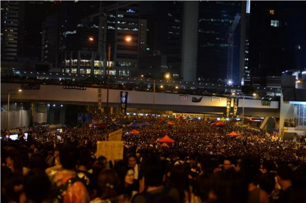 Hong Kong police fire tear gas at protesters commemorating fellow demonstrator - Reports