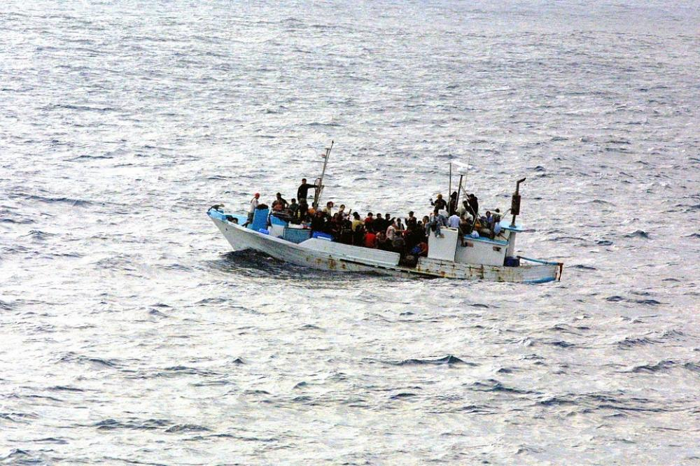 Vessel with 58 migrants reaches Italy