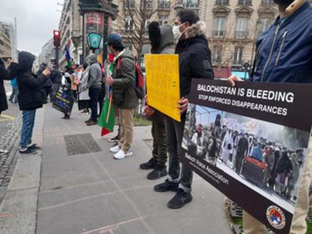 Demonstrators protest outside Canadian Embassy in Paris to demand justice for Karima Baloch