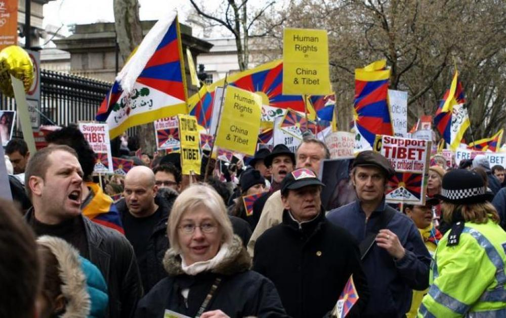 Tibetans demonstrate outside Chinese embassy in Paris against death of young monk Tenzin Nyima