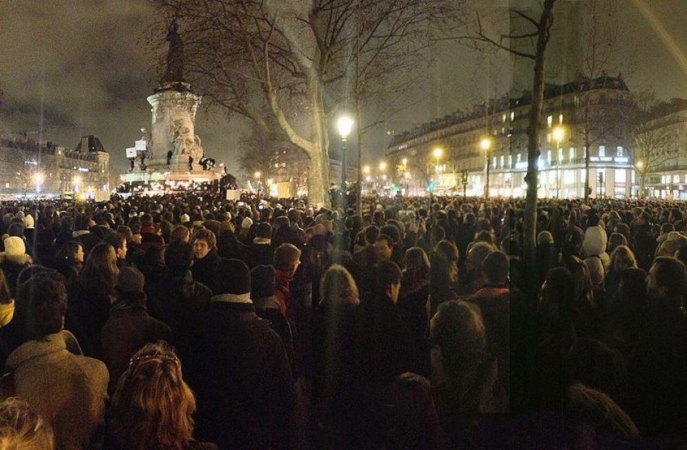 Demonstrators gather at the Place de la République in Paris on the night of the attack, Image by GodefroyParis /Creative Commons
